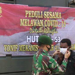 Penyemprotan Desinfektan dan Bagi Masker, Cara Yonif 411 Kostrad Sambut HUT Ke-53 Batalyon